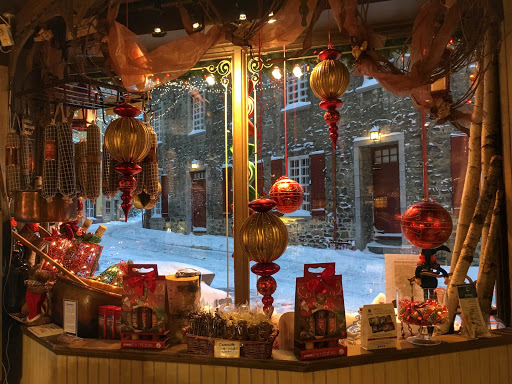 quebec-city-store.jpg - Christmas ornaments adorn the window of a charming old-timey store window in Quebec City, Canada.