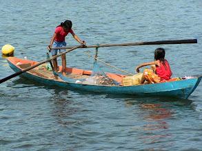Photo: Girls on a canoe