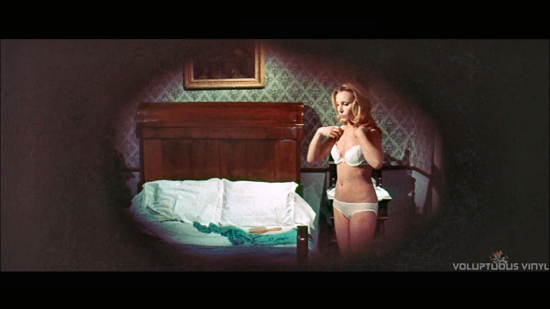 Dyanik Zurakowska being spied on while undressing in The Vampires Night Orgy