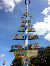 Photo: Maypole with flags from all of Munich's breweries. They take turns manning the beer counters.