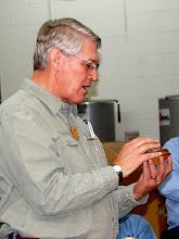 Photo: Bert Bleckwenn explains his small natural edge oak bowl.