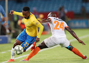 Mamelodi Sundowns attacker Lebohang Maboe (L) gets past Polokwane City defender Simphiwe Hlongwane during the 1-1 Absa Premiership draw at Loftus on February 19 2019.