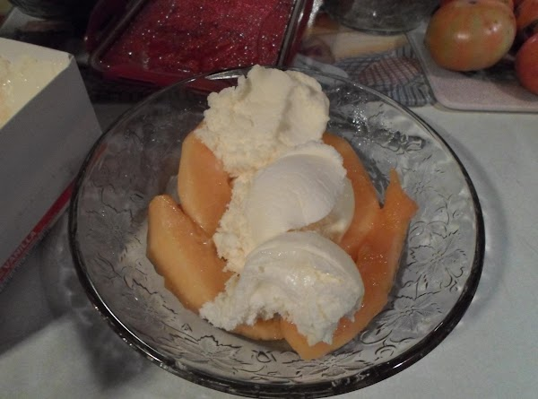 Take 3 scoops of vanilla ice cream and lay between the cantaloupe.