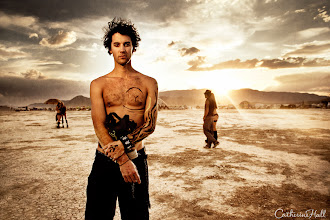 Photo: Exploration of a Muse  His Medusa-black hair is stained with thick playa dust – his piercing black-lined eyes rest intently in the direction of my lens. Even amid fire dancers, bare bodied beauties and thousands of bohemian Burning Man pilgrims, Eric Hudock cuts a striking outline against the stark landscape. Armed with my Canon 5DMII, I find myself invigorated by this close friend and muse, the subject of many of my fine art photographs. His striking features, complexity, and willingness to be vulnerable inspire my perpetual craving to explore the depth of human character.