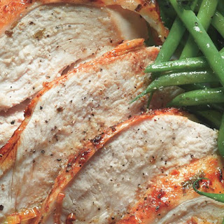 Roast Turkey Breast with Potatoes, Green Beans, and Mustard Pan Sauce.