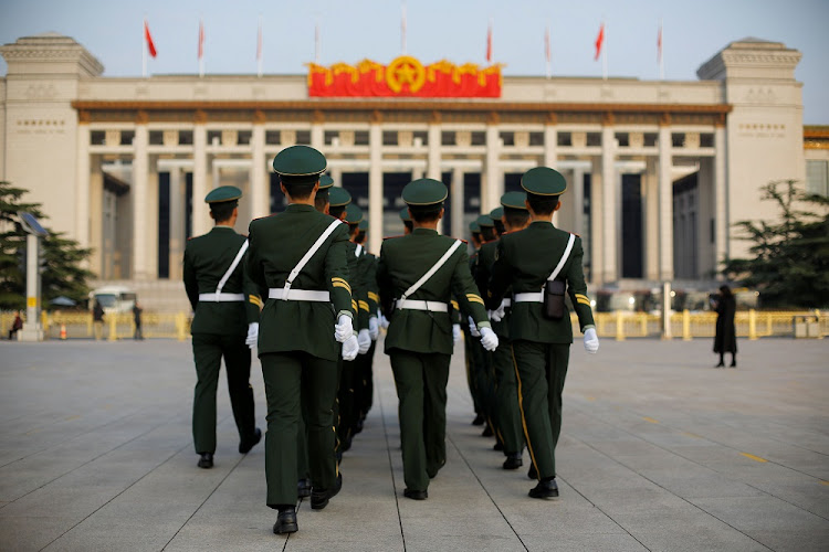 Chinese paramilitary police officers walk in formation on Tiananmen Square as the capital hosts the 19th National Congress of the Communist Party of China, in Beijing, China, on October 22 2017. Picture: REUTERS