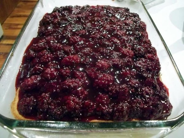 Spread the prepared blackberries evenly over the cake. Leave this cool completely.