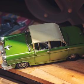 Green Toy Car by Edi Libedinsky - Artistic Objects Antiques ( green, car, wheel, toy, shelf,  )