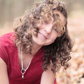 Wind Blown Hair by Sandy Considine - Babies & Children Child Portraits ( young girl, red dress, curly hair )