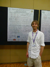 Photo: Tom at his poster (Photo Credit: Fusion Conferences)