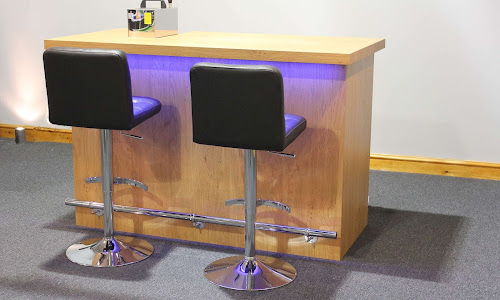 Premium bar Design with blue bar lights and two black bar chairs