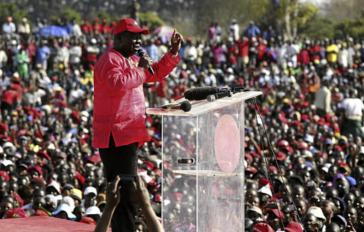 Movement for Democratic Change leader Morgan Tsvangirai addresses party supporters during a campaign rally in Chitungwiza, Zimbabwe, in July 2013. Picture: REUTERS