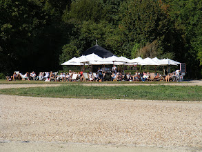 Photo: It may be mid-September, but there are still plenty of locals working on their tans near a garden café.