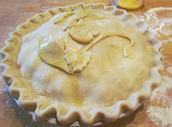 You should have a little extra pieces of pie dough to decorate with. Using...