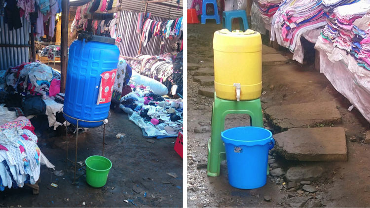 Toi Market traders are contributing to fill up these water jerry cans to maintain hygiene within the market.
