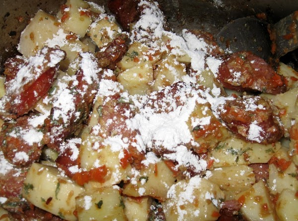 Now add back the sausage and add potatoes, along with the garlic powder, celery...
