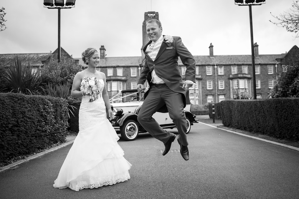groom-jumping-on-his-wedding