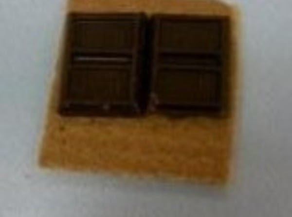 Place the chocolate side-by-side on top of 1 square of graham cracker on a...