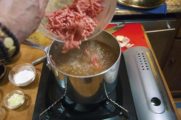 Bring to the boil, add the ground pork, and allow to simmer for 5...