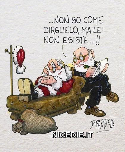 babbo natale steso sul lettino dello psicologo che gli dice: non so come dirglielo... ma lei non esiste !!!