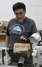 Photo: Ed has provided two nice maple logs with some ambrosia and great stain patterns along the core. Clif Poodry is going to turn a side-grain vessel. If you think that looks like end grain, you'd be correct -- first Clif wants to get those flat ends off, and this is the easiest and safest way to do it.