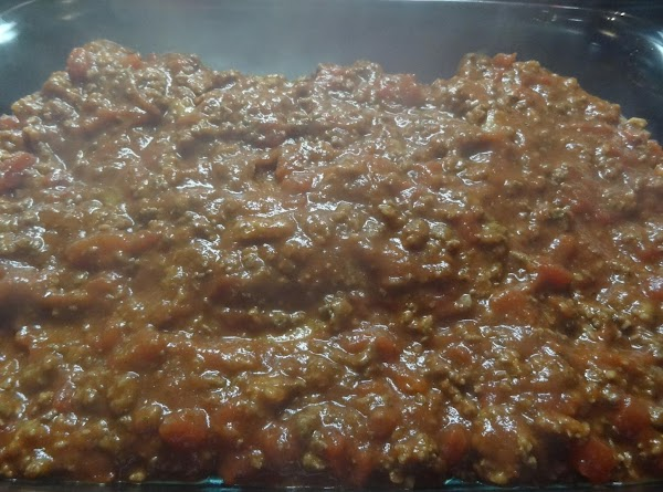 Brown ground beef in large pan.  Add tomato sauce, tomato paste, and spaghetti...