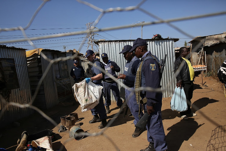 Siezed explosives are seen on the floor. The police conducted a multi-stakeholder operation in Matholesville, near Roodepoort. File photo