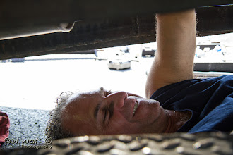 Photo: . . .  turning wrenches . . .