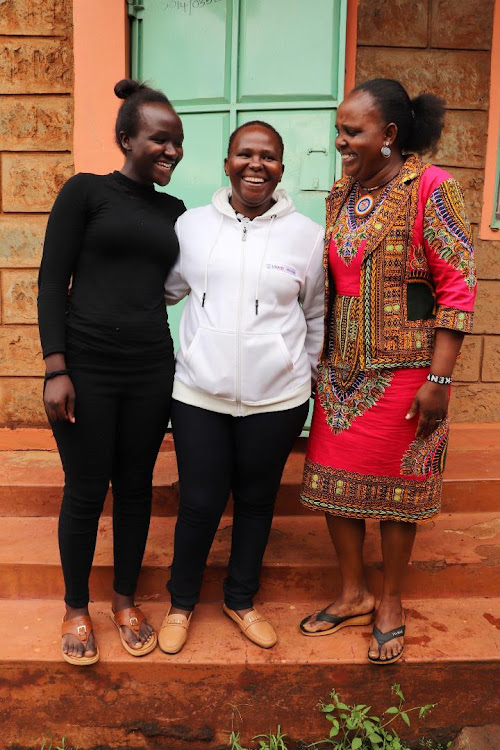 Dionisia Mugo (centre) her daughter and her friend