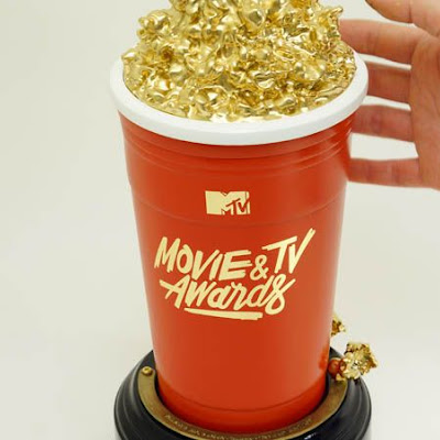 3d printing gallery image of a custom trophy made with abs plastic and sla resin 3d printed and gold plated, used as a commercial prop for a publicity marketing campaign