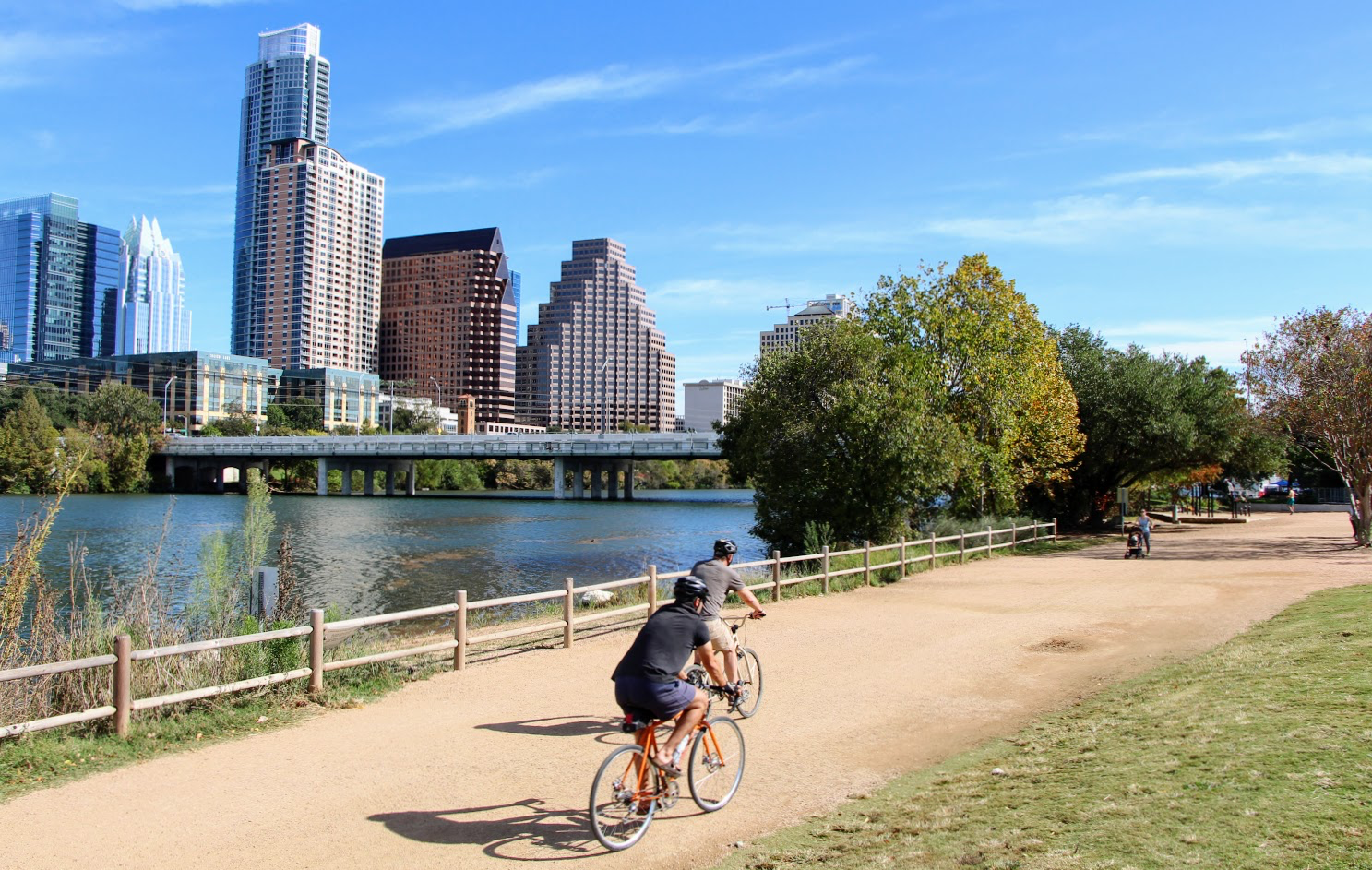 Two people biking on Lady Bird Lake Butler Trail, one place you can work out in Austin.