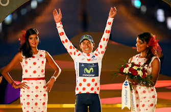 Photo: Nairo Alexander Quintana, of Colombia, raises his arms on the podium after the 21st and last stage of the 100th edition of the Tour de France cycling race over 133.5 kilometers (83.4 miles) with start in Versailles and finish in Paris, France, Sunday July 21 2013. (AP Photo/Bernard Papon, Pool) Cycling Tour de France