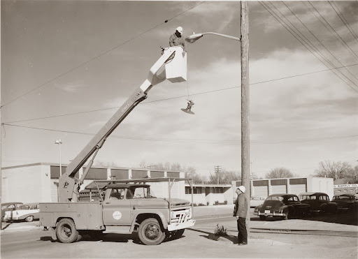 Utility bucket truck with worker