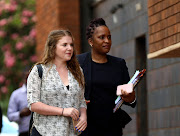 FILE PHOTO: U.S. citizen Martha O'Donovan (L), accused of attempting to subvert former President Robert Mugabe's government, leaves the courts in Harare, Zimbabwe December 8, 2017.
