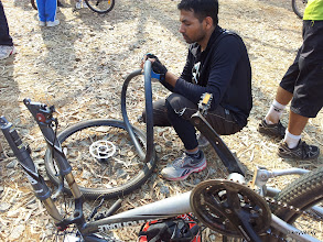 Photo: Fixing the flats after the race!