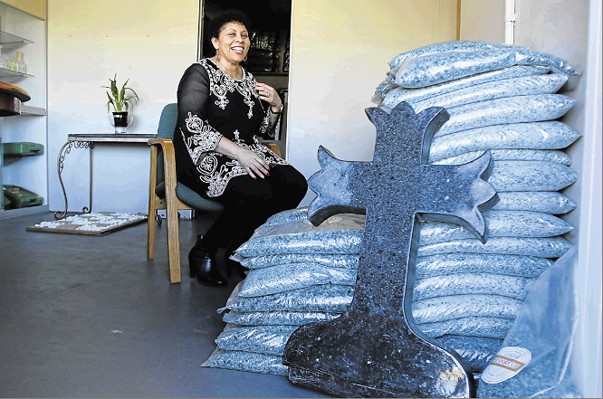 WASTE NOT: August 08 2018 , Deidre Nxumalo-Freeman of DNF waste services with some of the products made from recycled glass on display at their factory in Wilsonia.