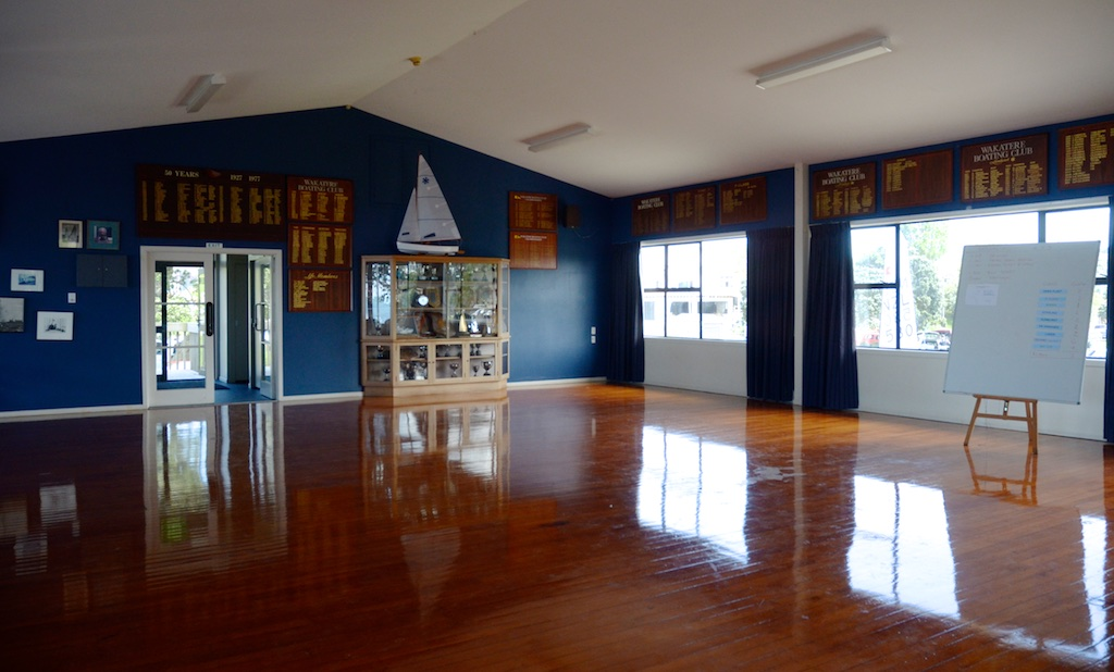 Photo: Interior view towards rear of venue. Long navy blue drapes cover these windows to focus the view towards the beach