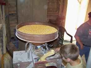 Photo: Dr. Wortham's Son Tending A Corn Grinder