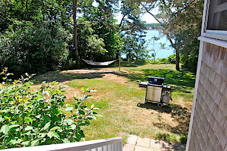 Photo: East lawn from dining porch.  Gas barbecue is available.