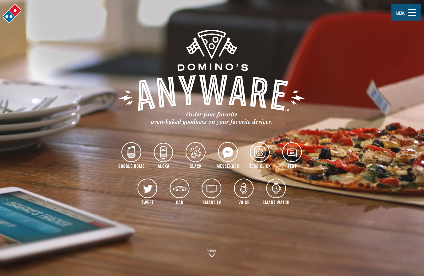 The Domino's pizza anyware site was accessed on Feburary 2, 2020 and shows a video background of a pizza on a table overlayed with low contrast text and icons.
