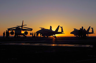 Photo: 061002-N-5024R-001Pacific Ocean (Oct. 02, 2006) - The sun sets over the flight deck of the nuclear-powered aircraft carrier USS John C. Stennis after a long day of flight operations. Stennis and embarked Carrier Air Wing Nine (CVW-9) are currently Composite Training Unit Exercise (COMPTUEX) off the coast of Southern California. U.S Navy photo by Mass Communication Specialist 1st Class Johnnie Robbins (RELEASED)