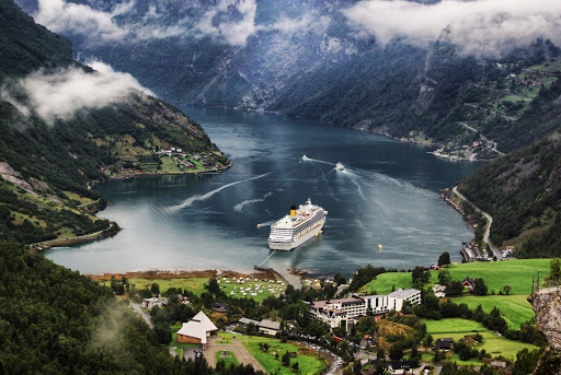 Costa Magica alights in Geiranger village at the head of the Geirangerfjord, which is a branch of the Storfjord in Norway.