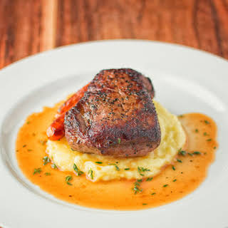 Steak With Thyme White Wine Reduction And Truffled Mashed.