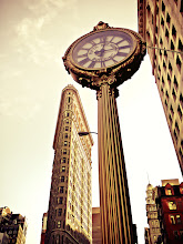 """Photo: """"Cast-iron...""""  I have always loved the ornate clocks that line 5th Avenue, especially the Fifth Avenue Building Block that has a prime destination near the Flatiron Building. At 19 feet high, the cast-iron clock was installed in 1909 and was crafted by a Brooklyn Iron Works company. It's a type of clock that was introduced in the 1860s. They were popular with business owners who wanted to attract extra attention and also served a functional purpose as time-telling pieces in a busy area of Manhattan.  The juxtaposition between the Flatiron Building, one of New York City's iconic skyscrapers and this cast-iron clock has always put a smile on my face. The Flatiron Building, which was completed in 1902 is also a landmark in Manhattan. Its name is in reference to its resemblance to a cast-iron clothes iron.    New York Photography: The Flatiron Building and 5th Avenue Building Clock    You can view this post along with information about where to purchase prints of this image at my site here:  http://nythroughthelens.com/post/36355612673/the-flatiron-building-and-fifth-avenue-building  -  Tags: #photography  #newyorkcity  #newyorkcityphotography  #nyc  #manhattan  #clock  #flatironbuilding  #5thavenueclock  #fifthavenueclock  #skyscraper  #mobilephotography  #iphonography  #iphonographyfriday  #iphonephotography  #mobilography  #antiqueclock  #steampunk  #steampunkclock"""