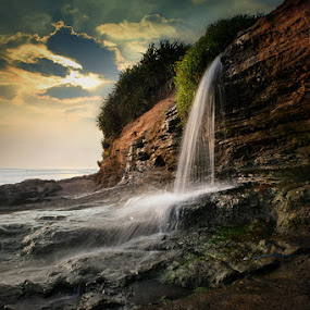 Waterfall Kelating Beach by Widia Widana - Landscapes Beaches