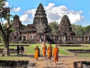 Photo: monks visiting the Khmer sanctuary of Prasat Hin Phimai