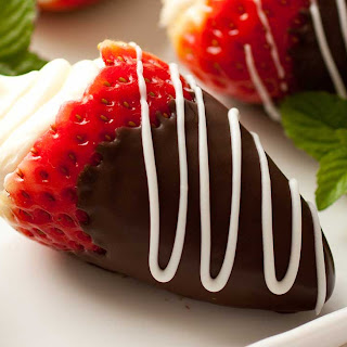 Mascarpone-Stuffed Strawberries Dipped in Chocolate.