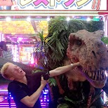 getting my hand eaten by a dinosaur at the Robot Restaurant in Kabukicho in Kabukicho, Tokyo, Japan