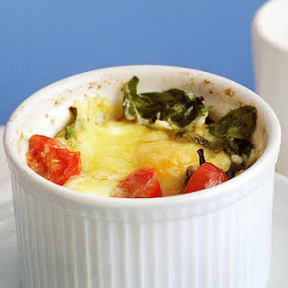 Baked Eggs with Bacon, Tomato and Spinach.