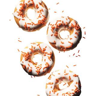Pumpkin Doughnuts With Sour Cream Icing.